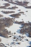 Little country farm in the birch groves in winter, top view. Little country farm in the birch groves in winter, aerial view Stock Images