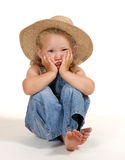 Little country girl. Girl sitting an looks funny Royalty Free Stock Images
