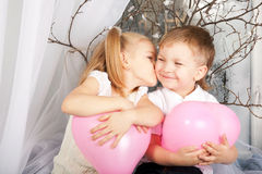 Little couple of kids hugging, kissing Royalty Free Stock Photos