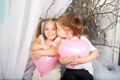 Little couple of kids  kissing Stock Photos