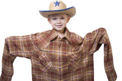 Little Cowboy. A little boy wearing a cowboy hat and a big shirt Royalty Free Stock Images