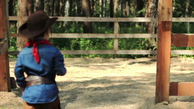 Little Cowboy comes to an empty paddock stock footage