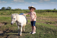 Little cowboy and pony horse. Child little cowboy and pony horse Royalty Free Stock Image