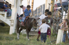 Little cowboys riding pony. At PRCA Rodeo at Lower Brule, Lyman County, Lower Brule Sioux Tribal Reservation, South Dakota, 58 miles Southeast of Pierre near royalty free stock photography