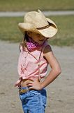Little Cowgirl. Strikes a pose and looks to the right stock photos