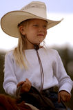 Little Cowgirl on Horseback #1. Portrait of little cowgirl on horseback royalty free stock images