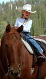 Little Cowgirl on Horseback #2. Little cowgirl on back of bay horse royalty free stock photos