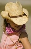 Little Cowgirl Portrait. Little cowgirl in woven cowboy hat poses for the camera stock images