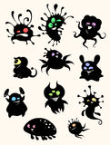 Little creatures. Cute little monsters in black silhouette Stock Images