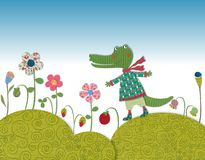 Little crocodile walking on flowering meadow Stock Images