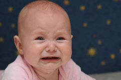 Little Crying Baby. 5 months crying Baby with blue eyes Stock Photos
