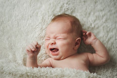 Little crying boy at home Stock Images