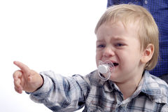 Little crying child. Pointing with his finger Royalty Free Stock Photos