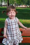 Little crying girl in park Royalty Free Stock Image