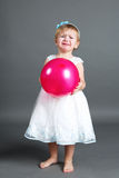 Little crying girl with pink balloon Royalty Free Stock Images