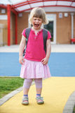Little Crying Girl Standing Outside Pre School Building Royalty Free Stock Image