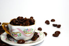 Little cup with coffee beans on grunge Royalty Free Stock Images