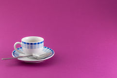 Little cup of coffee on colored background Royalty Free Stock Photography