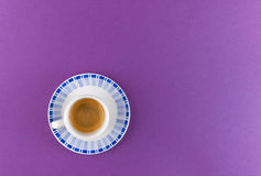 Little cup of coffee on colored background Stock Photos