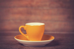 Little cup of the coffee on a wooden table Stock Image
