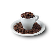Little cup filled with coffee beans on saucer Royalty Free Stock Photography