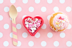 Little cupcake with pink frosting Royalty Free Stock Photo