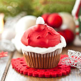 Little cupcake with Santa hat Stock Photo