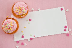 Little cupcakes on pink Royalty Free Stock Images