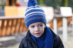 Little curious boy in winter cap Royalty Free Stock Photos