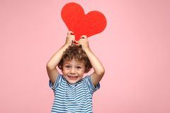 Charming kid posing with heart Stock Images