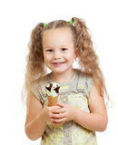 Little curly girl eating ice cream in studio Stock Photography
