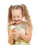 Little curly girl eating ice cream in studio Royalty Free Stock Photo