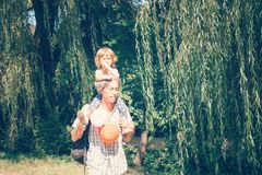A little curly girl and her father are a close family. Stock Image