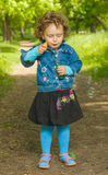 Little curly girl with soap bubbles Stock Photography