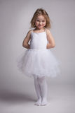Little curly girl in a ballet dress Stock Photos