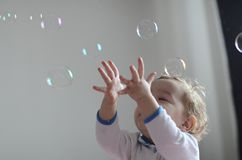 Girl playing with soap bubbles royalty free stock photography