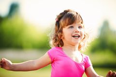 Little curly happy girl running portrait Stock Photo