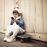 Little curly hipster girl urban portrait Royalty Free Stock Images