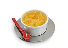 Little custard with a red ceramic spoon Royalty Free Stock Photo