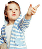 Little cute adorable baby girl pointing isolated on white close up, sweet toddler Stock Image