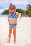 Little cute adorable girl in swimsuit rubs Royalty Free Stock Photography
