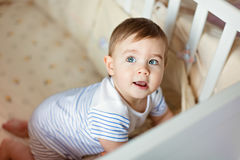 Little cute adorable little blond boy in a striped bodykit creep Royalty Free Stock Image