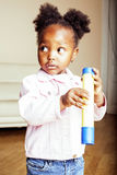 Little cute african american girl playing with animal toys at ho Stock Photography