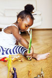 Little cute african american girl playing with animal toys at ho Royalty Free Stock Photography