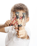 Little cute angry boy with slingshot isolated Royalty Free Stock Photo