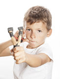 Little cute angry boy with slingshot isolated. Little cute angry real boy with slingshot isolated stock photos