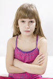Little cute angry girl. Looking at camera royalty free stock photos