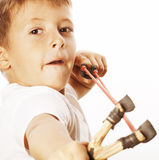 Little cute angry real boy with slingshot isolated. Close up royalty free stock photo