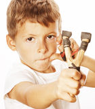 Little cute angry real boy with slingshot isolated Stock Image
