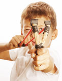 Little cute angry real boy with slingshot isolated Royalty Free Stock Image
